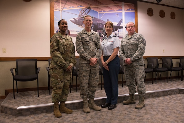 (Left to Right) Major Shawna Parker, deputy director of revitalizing squadrons task force, Col. Russell Williford, director of revitalizing squadrons task force, Col. Heather Thorne-Albright, Royal Canadian Air Force family advocate, and Chief Master Sgt. Johnathan Hover, chief of revitalizing squadrons task force, pose for a group photo at Luke Air Force Base, Ariz., Jan. 17, 2019. The task force visited Luke to promote practices and identify improvements which need to be made in achieving squadron revitalization initiatives. (U.S. Air Force photo by Senior Airman Caleb Worpel)