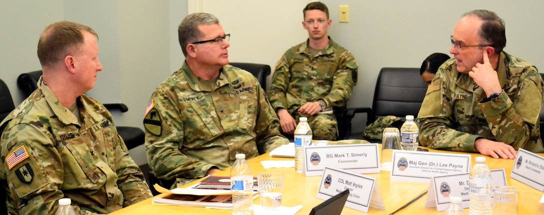 Air Force Maj. Gen. Lee Payne, DHA's Combat Support Agency assistant director, right, talks with Army Brig. Gen. Mark Simerly, DLA Troop Support commander, center, and Army Col. Matthew Voyles, Medical supply chain director, left, during a visit Jan. 11, 2019 in Philadelphia.