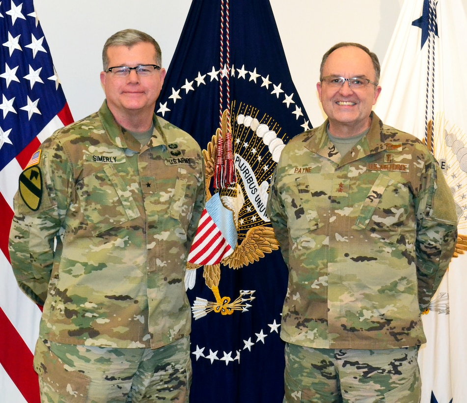 Army Brig. Gen. Mark Simerly, DLA Troop Support commander, left, poses with Air Force Maj. Gen. Lee Payne, DHA's Combat Support Agency assistant director, right, during a visit Jan. 11, 2019 in Philadelphia.