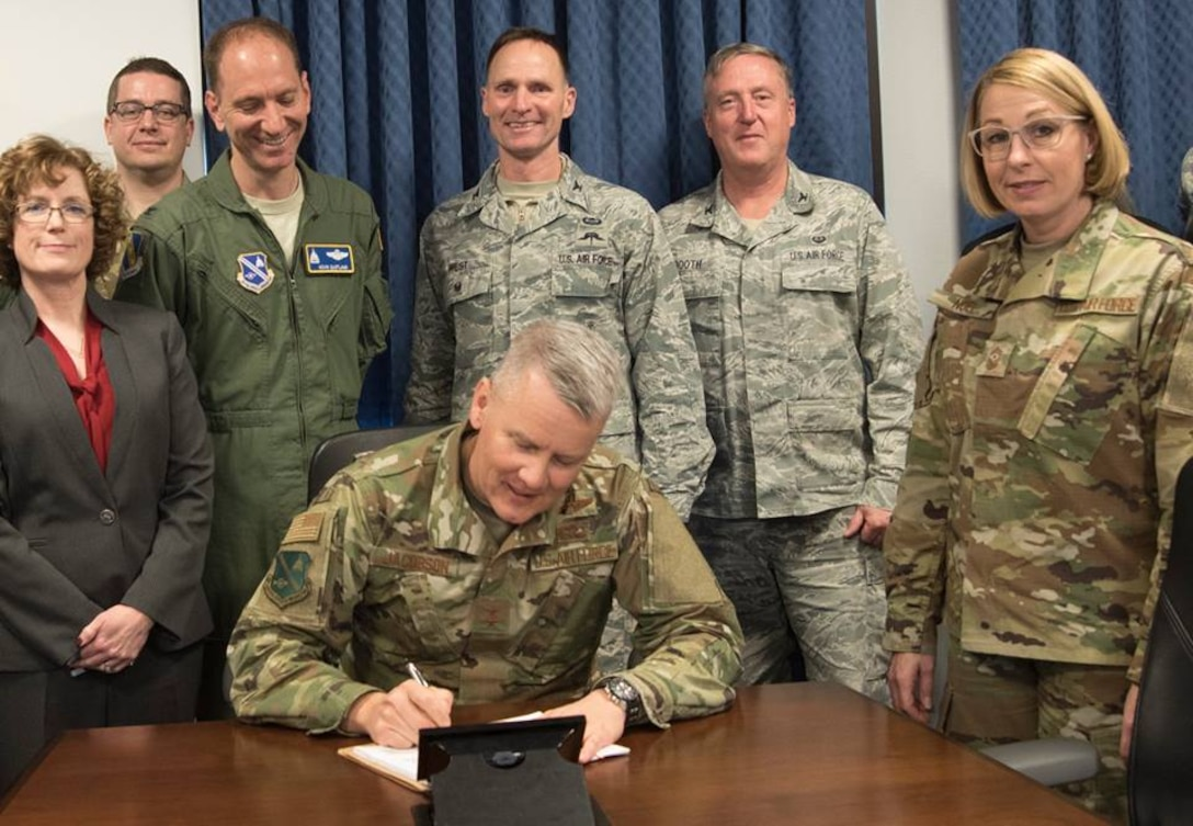 Maj. Gen. James A. Jacobson signs the newly released 2018-2023 Strategic Plan Jan. 23.