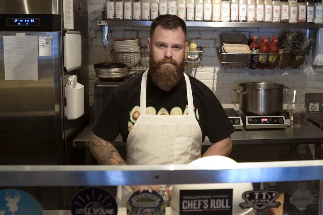 Chef stands in restaurant kitchen