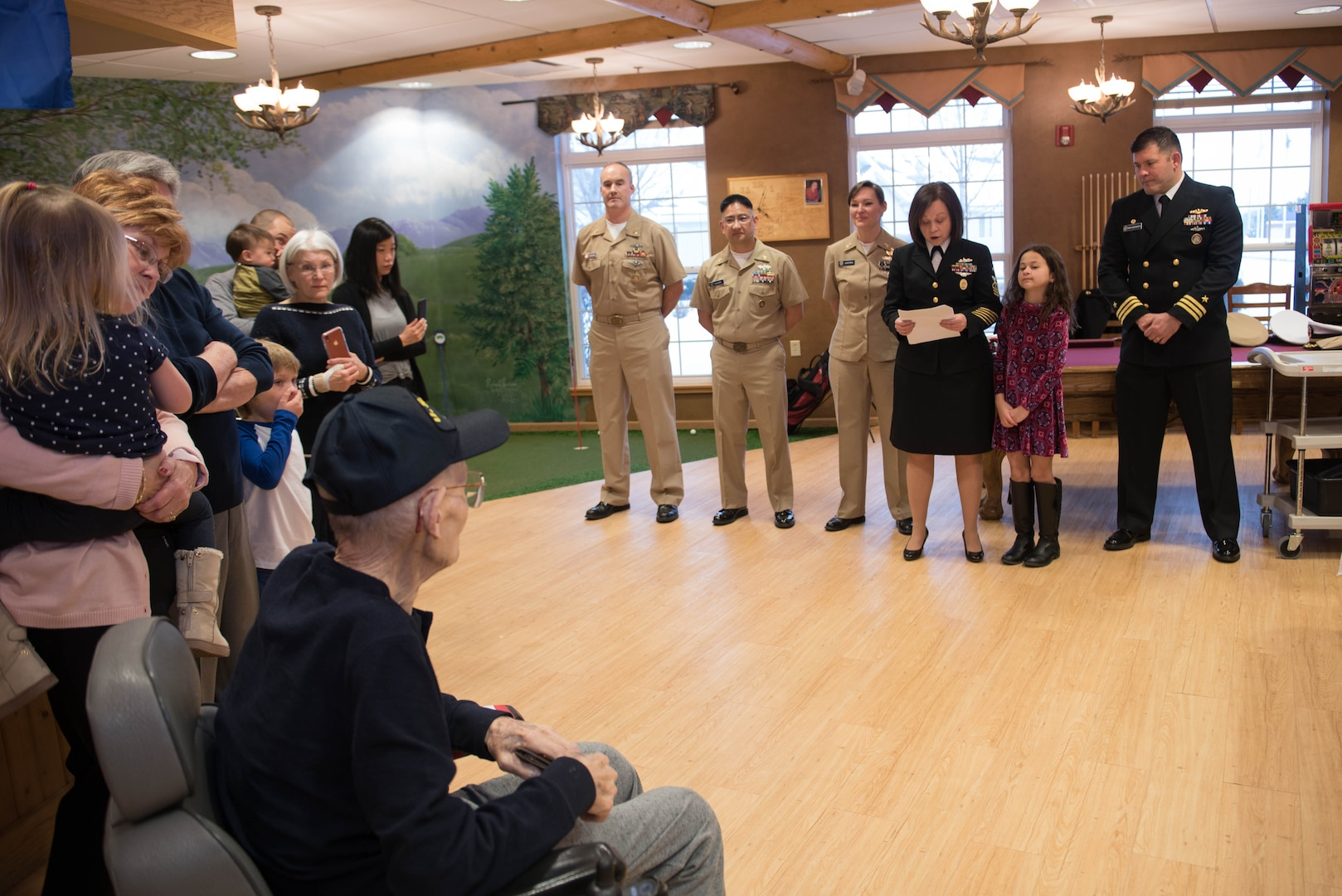 Senior Chief Petty Officer Lisa Vrtiska, U.S. Strategic Command Navy Element senior enlisted leader, thanks Navy veteran Chief Petty Officer Leonard Kulceski for his service during at a veteran recognition ceremony at Hillcrest Mable Rose in Papillion, Nebraska, Jan. 18, 2019. During the ceremony, Kulceski was presented a certificate, pin, blanket and a salute from chief petty officers to honor his service to his country. (U.S. Air Force photo by Zachary Hada)