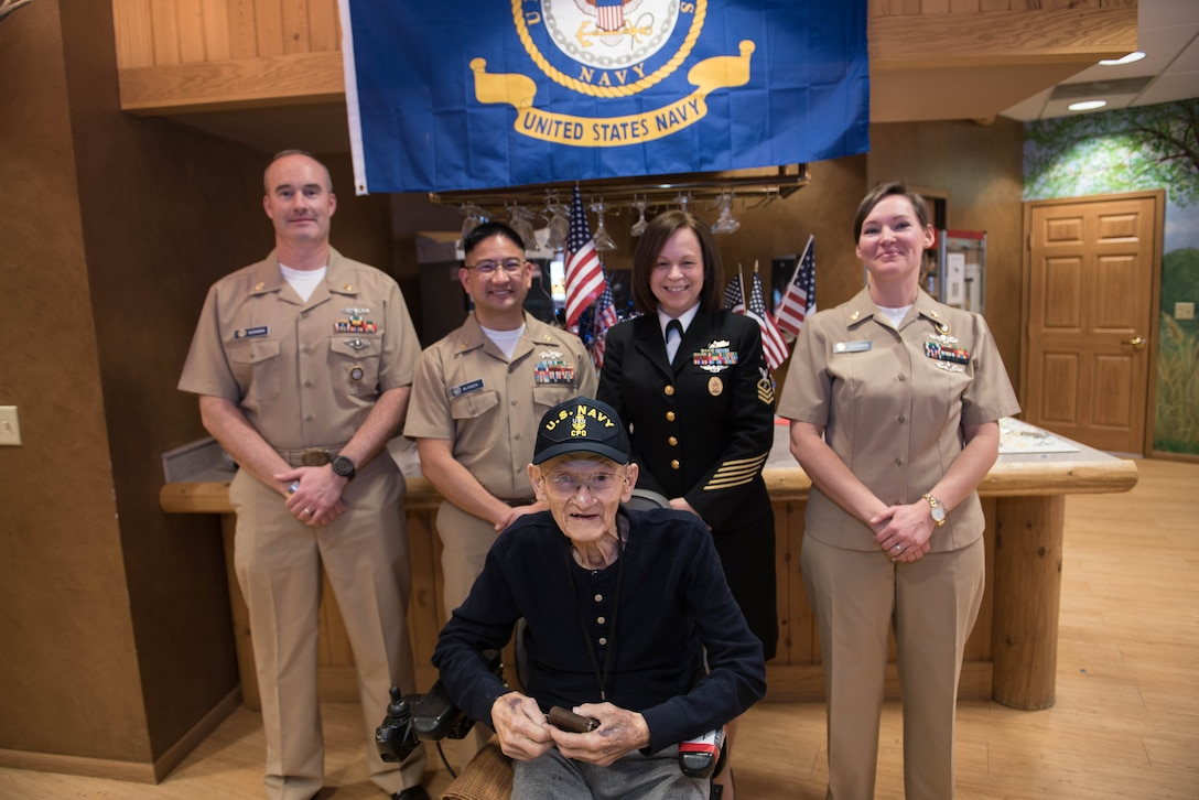 Navy veteran Chief Petty Officer Leonard Kulceski poses for a photo with chief petty officers from the U.S. Strategic Command Navy Element during a veteran recognition ceremony at Hillcrest Mable Rose in Papillion, Nebraska, Jan. 18, 2019. Kulceski was in the Cavite Navy Yard, the second place to be bombed during World War II. (U.S. Air Force photo by Zachary Hada)
