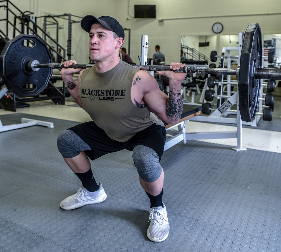Staff Sgt. Adam Pipp, an aerospace ground equipment journeyman assigned to the 115th Maintenance Group, Truax Field, Wisconsin, exercises in the base fitness center Jan. 24, 2019. (U.S. Air National Guard photo by Tech. Sgt. Mary E. Greenwood)