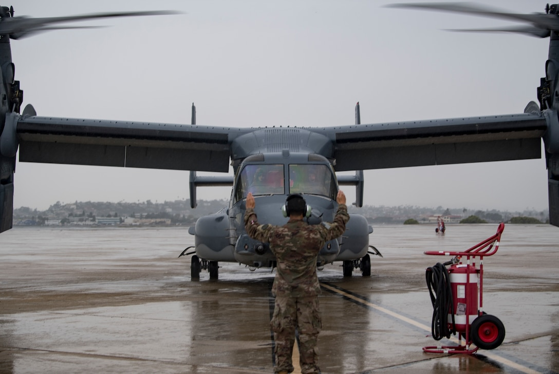 One person and one aircraft on a flightline.