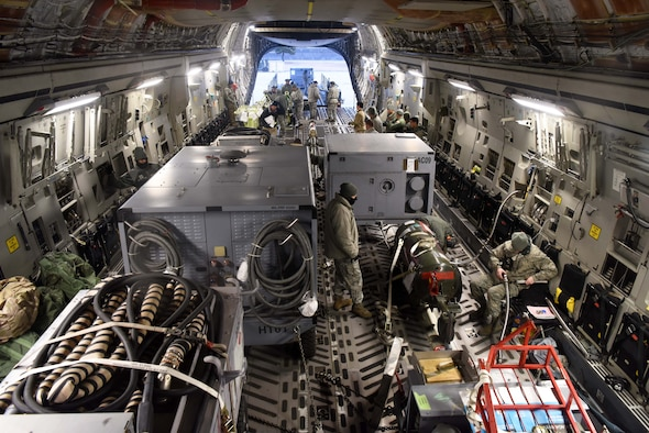 Members of the 8th Logistics Readiness Squadron load cargo onto a C-17 Globemaster III at Kunsan Air Base, Republic of Korea, Jan. 15, 2019. The 8th LRS helped load and ensured passenger were ready prior to departure. (U.S. Air Force photo by Staff Sgt. Joshua Edwards)