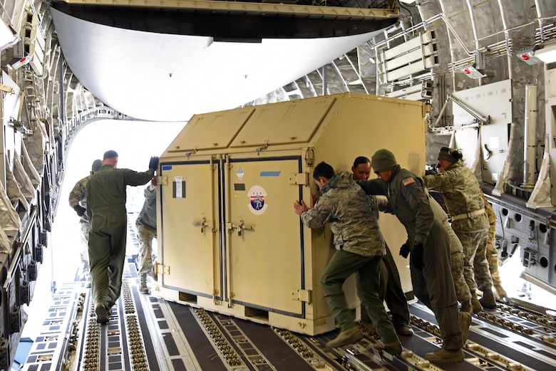 Members of the 8th Logistics Readiness Squadron load cargo onto a C-17 Globemaster III at Kunsan Air Base, Republic of Korea, Jan. 17, 2019. The 8th LRS helped load and ensured passenger were ready prior to departure. (U.S. Air Force photo by Staff Sgt. Joshua Edwards)