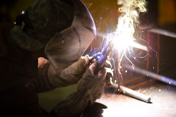 U.S. Air Force Staff Sgt. Angelica Figueroa, 8th Civil Engineer Squadron structural craftsman, welds beading on a piece of metal at Kunsan Air Base, Republic of Korea, June 22, 2018. Structural Airmen are trained in a wide range of skills including woodworking, metal work, and masonry. (U.S. Air Force photo by Tech. Sgt. Charles McNamara)