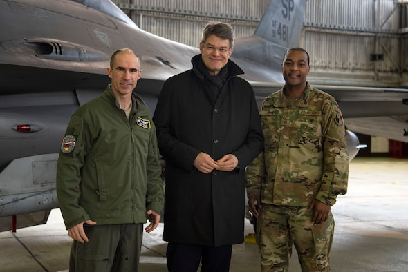 U.S. Air Force Col. Jason Bailey, 52nd Fighter Wing commander, left, and Chief Master Sgt. Alvin Dyer, 52nd FW command chief, right, welcome Patrick Schnieder, member of the German Federal Parliament in Berlin, center, to Spangdahlem Air Base, Germany, Jan. 24, 2019. Schnieder represents the county of Bitburg, Germany, for the Christian Democratic Union. The visit gave Schnieder an opportunity to learn about base functions. (U.S. Air Force photo by Airman 1st Class Valerie Seelye)