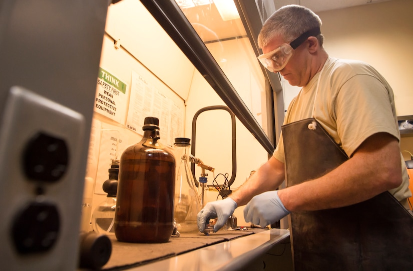 Tech. Sgt. Steven Jenkins, 379th Expeditionary Logistics Readiness Squadron (ELRS) fuels lab NCO in charge, begins a 'bottle method' as part of a fuel inspection Jan. 24, 2019, at Al Udeid Air Base, Qatar. As part of his job, Jenkins analyzes various fuel types including gasoline, diesel fuel and Jet Propellant 8, to ensure they are free of contaminants before use in aircraft and vehicles. Airmen from the 379th ELRS fuel lab retrieve samples for testing from various sources including pipelines, trucks and fuel tanks.   (U.S. Air Force photo by Tech. Sgt. Christopher Hubenthal)
