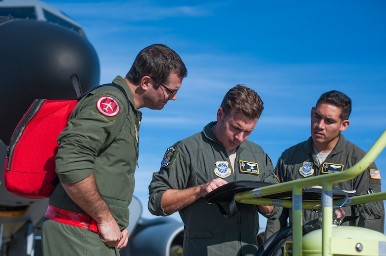 Aircrew members assigned to the 6th Air Mobility Wing go over their pre-flight checklist before a refueling mission supporting Exercise Emerald Warrior, Jan. 17, 2019 at MacDill Air Force Base, Fla.