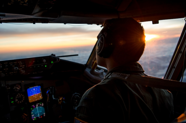 U.S. Air Force 1st Lt. Sean Thomas, a 91st Air Refueling Squadron KC-135 Stratotanker pilot, scans the evening horizon for the receiver aircraft during an aerial-refueling mission supporting Exercise Emerald Warrior, Jan. 17, 2019 over the Gulf of Mexico.