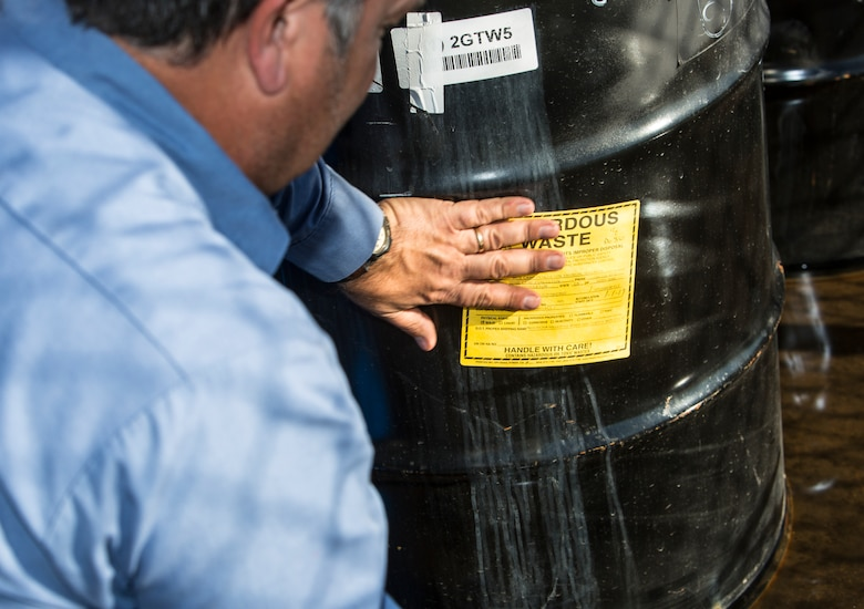 Robert Twineham, operations manager with Industrial Waste Utilization, labels hazardous waste drums at the Marine Wing Support Squadron-372 60 day hazardous material storage site at Marine Corps Base Camp Pendleton, California, Jan. 23, 2019. Twineham was preparing the hazardous waste for transport form the site to a waste management facility where it would be recycled.