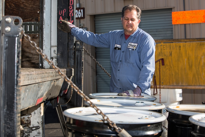 Robert Twineham, operations manager with Industrial Waste Utilization, loads drums of hazardous material waste onto a trunk at the Marine Wing Support Squadron-372 60 day HAZMAT storage site, Marine Corps Base Camp Pendleton, California, Jan. 23, 2019. Twineham was transporting the hazardous waste from the site to a waste management facitlity where it would be recycled.