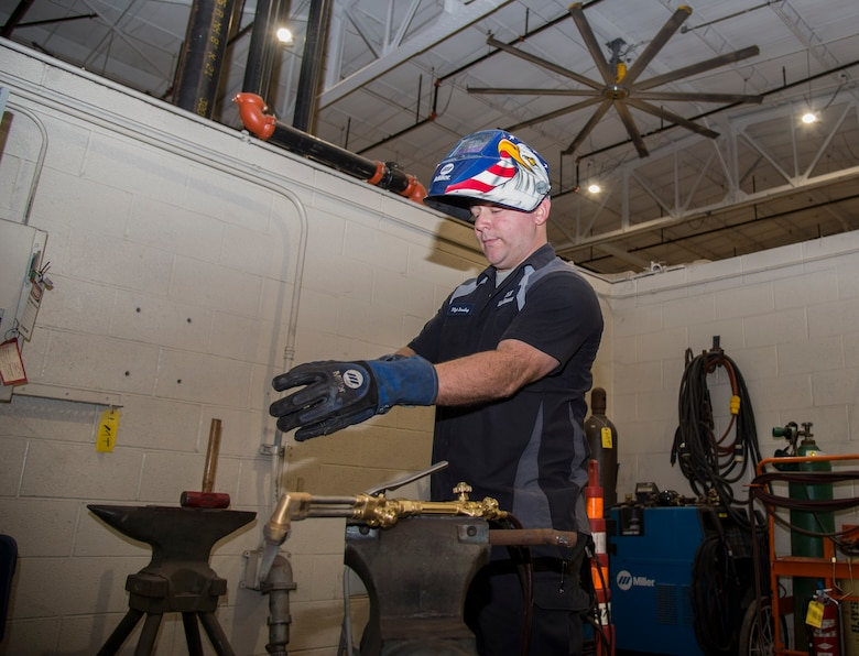 Tech. Sgt. Brian Bradley, 375th Logistics Readiness Squadron vehicle maintenance technician, puts on the required personal protective equipment before he starts welding Jan. 10, 2019, at Scott Air Force Base, Ill. Welding is used by the vehicle maintenance flight to fabricate parts out of raw materials, so they can be used to repair vehicles.
