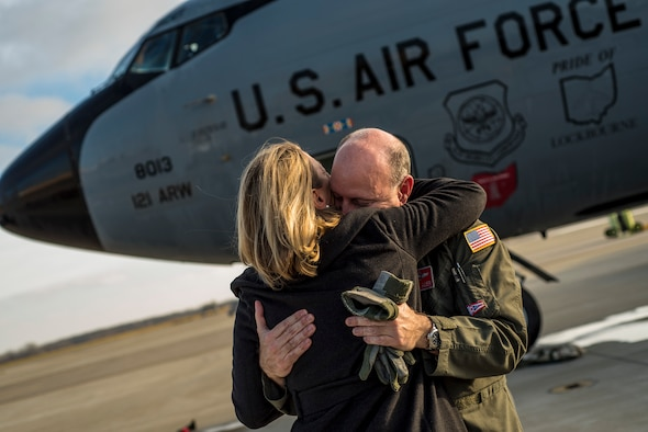 Col. Mark Auer, 121st Air Refueling Wing commander, hugs his wife, Nancy, after his final flight