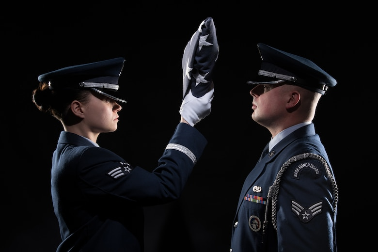Honor guard members demonstrate a flag-folding ceremony