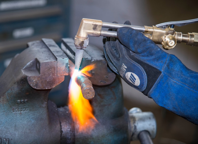 Tech. Sgt. Brian Bradley, 375th Logistics Readiness Squadron vehicle maintenance technician, welds a steel bar in the fabrication workshop Jan. 10, 2019, at Scott Air Force Base, Ill. The vehicle maintenance flight uses the fabrication workshop to create parts not readily available in the shop but are required to maintain vehicles.