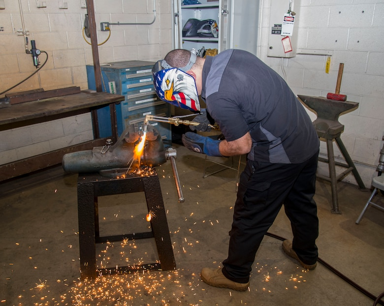 Tech Sgt. Brian Bradley, 375th Logistics Readiness Squadron vehicle maintenance technician, welds a steel bar in the fabrication workshop Jan.10, 2019, at Scott Air Force Base, Ill. Vehicle maintenance receives approximately five vehicles a week in need of repair.