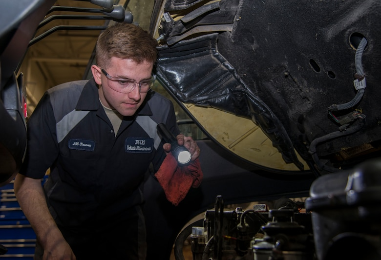 Airman 1st Class Aaron Turner, 375th Logistics Readiness Squadron vehicle maintenance technician, inspects the engine compartment of a forklift Jan. 10, 2019, at Scott Air Force Base, Ill. Turner inspects the vehicle by checking the oil, ensuring the parts aren't damaged, and cleaning the grease and grime off of the engine parts.