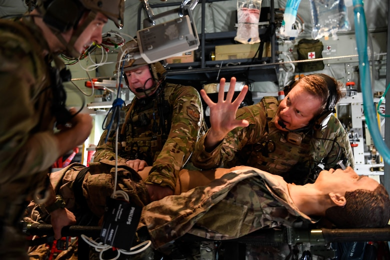 Maj. John Richardson, right, 27th Special Operations Support Squadron physician, practices medical care on a simulated patient during exercise Emerald Warrior/Trident