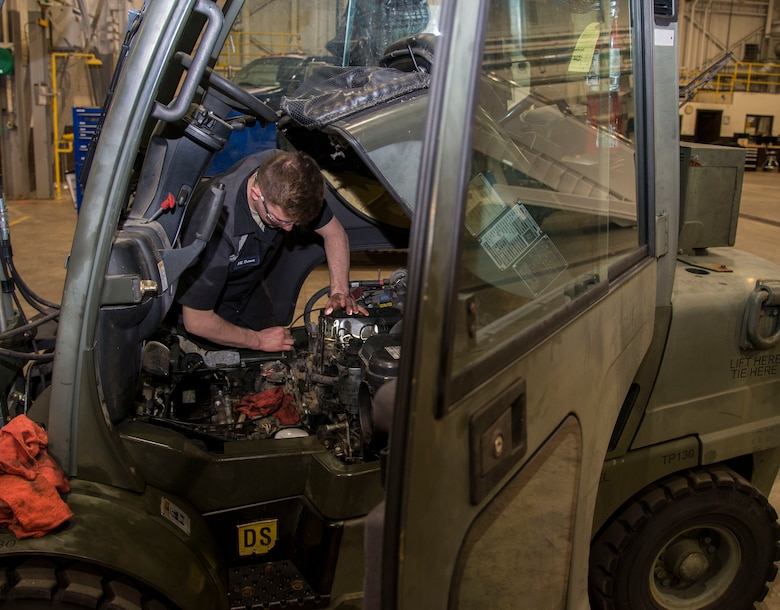 Airman 1st Class Aaron Turner, 375th Logistics Readiness Squadron vehicle maintenance technician, inspects one of the engine parts on a forklift Jan. 10, 2019, at Scott Air Force Base, Ill. The vehicle maintenance flight is comprised of 14 Airmen and civilians who are responsible for ensuring that all the vehicles assigned to Scott are working and are properly maintained.