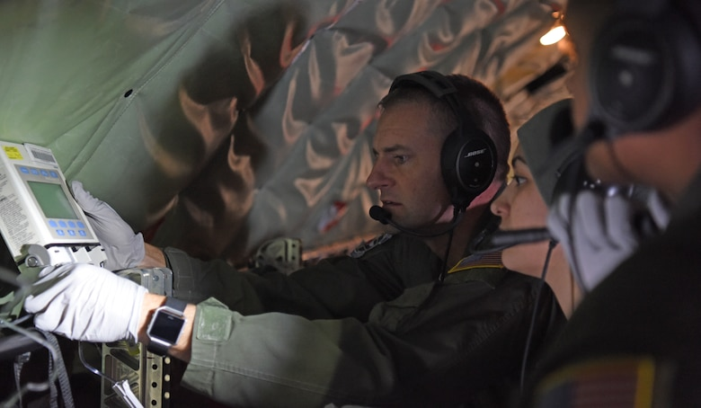 U.S. Air Force Maj. Jeremy Hicks, left, 86th Aeromedical Evacuation Squadron flight nurse, shows members of the 86th AES how to administer intravenous bags during training aboard a KC-135 Stratotanker over the skies of Germany, Jan. 23, 2019. The 86th AES are charged with providing aeromedical care for both U.S. European Command and U.S. Africa Command, which is the largest area of responsibility out of all existing aeromedical evacuation squadrons. (U.S. Air Force photo by Airman 1st Class Brandon Esau)