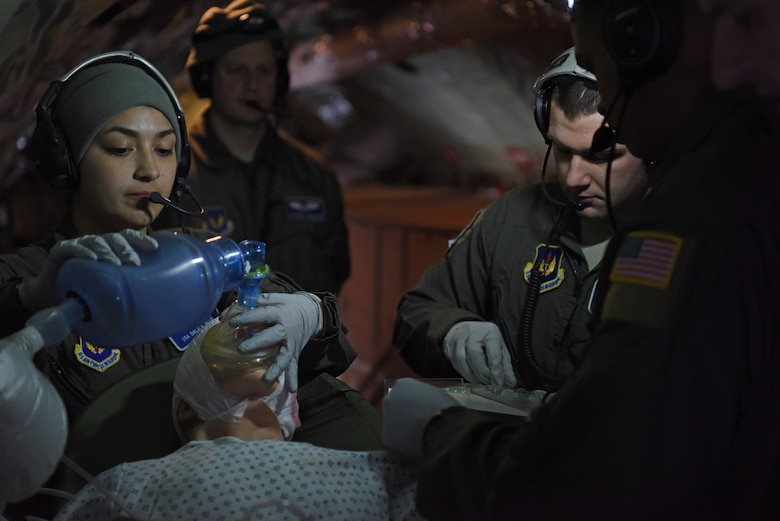 Members of the 86th Aeromedical Evacuation Squadron from Ramstein Air Base, Germany perform resuscitating procedures during training aboard a KC-135 Stratotanker over the skies of Germany, Jan. 23, 2019. The aeromedical evacuation team consisted of two flight nurses, three aeromedical technicians and a collection of instructors and evaluators, who graded the annual evaluation of the squadron. (U.S. Air Force photo by Airman 1st Class Brandon Esau)