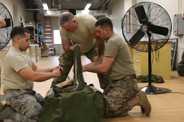 The G12E Parachute is the focus of cross-training for Soldiers from the 56th Quartermaster Rigger Support Team, RI Army National Guard and their RI Air National Guard counterparts, January 5, 2019, Quonset Point, North Kingstown RI. Training on the G12E Cargo Parachute increases proficiency on air drop systems and improves interoperability.  (U.S. Army National Guard Photo by Sgt. 1st Class Michael A. Simmons)