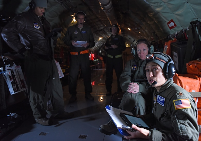 U.S. Maj. Mario Rocio Vazquez, 86th Aeromedical Evacuation Squadron medical crew director from Ramstein Air Base, Germany, provides a pre-flight brief prior to training aboard a KC-135 Stratotanker over the skies of Germany, Jan. 23, 2019. The aeromedical evacuation team consisted of two flight nurses, three aeromedical technicians and a collection of instructors and evaluators, who graded the annual evaluation of the squadron. (U.S. Air Force photo by Airman 1st Class Brandon Esau)