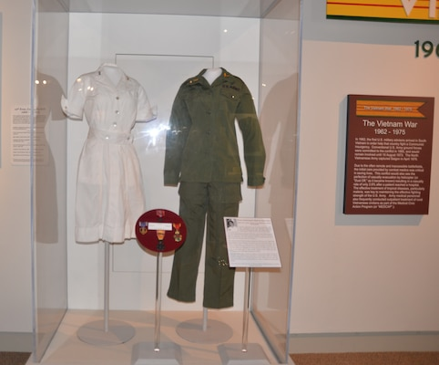 The duty dress and utility fatigue trousers and shirt worn by 1st Lt. Sharon Lane, a U.S. Army nurse who served in the Vietnam War, are included in a new exhibit about Lane recently installed at the U.S. Army Medical Department Museum at Joint Base San Antonio-Fort Sam Houston. Lane was killed in June 1969 at the 312th Evacuation Hospital in Chu Lai, South Vietnam from mortar and rocket fire directed at the hospital by Viet Cong forces. Other artifacts in the exhibit include the Bronze Star and Purple Heart medals awarded to her posthumously, and interpretative signage about Lane's life, service and death. Lane was the only U.S. military nurse killed by enemy fire during the Vietnam War.
