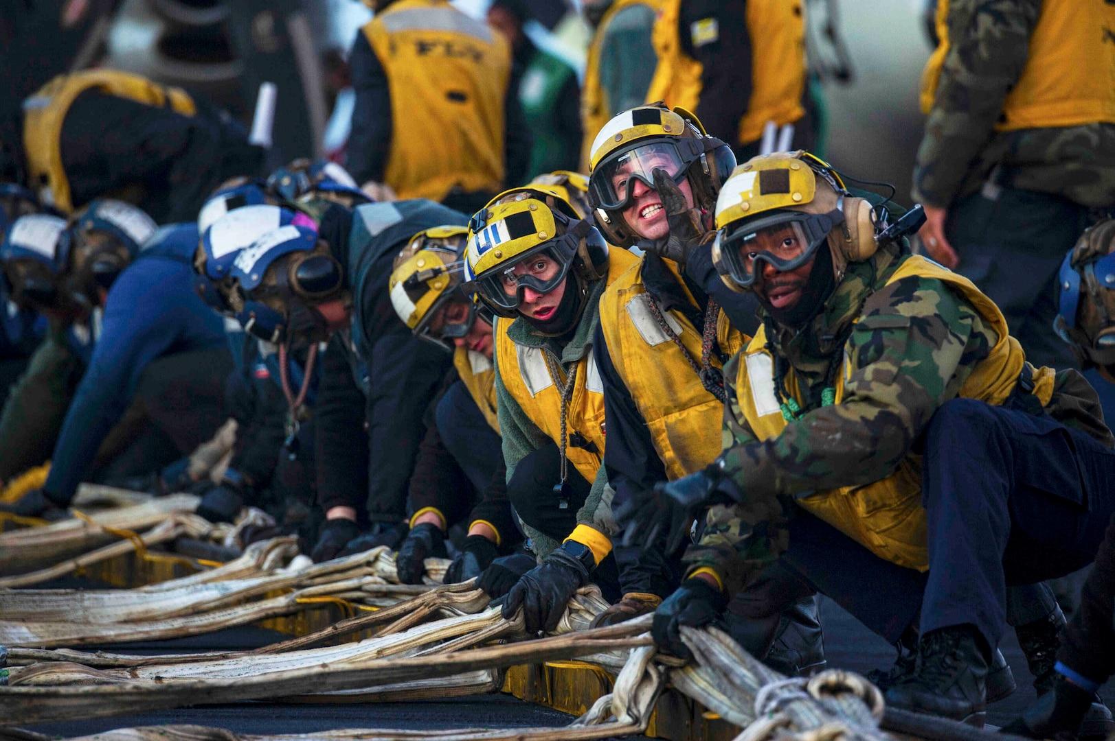 Sailors rig barricade during drill on flight deck aboard Nimitz-class aircraft carrier USS Harry S. Truman, December 2, 2018, Mediterranean Sea (U.S. Navy/Rebekah A. Watkins)