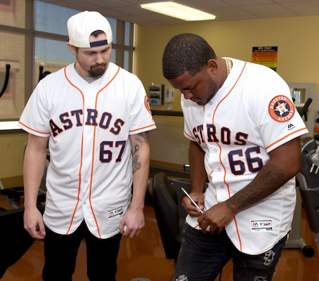 Houston Astros pitchers Dean Deetz (left) and Rogelio Armenteros (right), stopped by the U.S. Army Institute of Surgical Research Burn Center at Joint Base San Antonio-Fort Sam Houston to visit with burn patients, sign autographs and tour the facility Jan. 24. Shane Reynold, who pitched for the Astros from 1992 to 2002, and Astros broadcaster Alex Trevino were also with Deetz and Armenteros during the visit.
