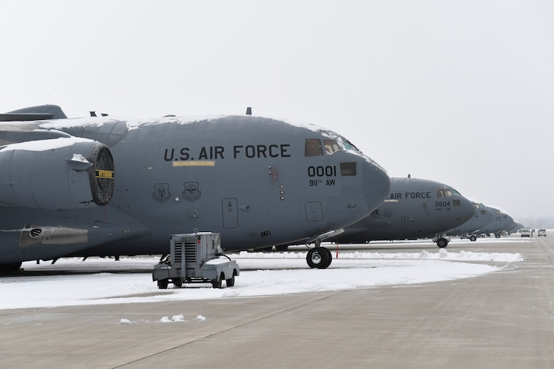 C-17 Globemaster III aircraft assigned to the 911th Airlift Wing and the 445th Airlift Wing sit on the flightline at Wright-Patterson Air Force Base, Ohio, January 15, 2019. The aircraft assigned to the 911th AW are temporarily at Wright-Patterson AFB due to the 911th AW's base conversion from the C-130 aircraft to the C-17 aircraft, including the addition of a new hangar and changes to the flightline. (U.S. Air Force photo by Joshua J. Seybert)