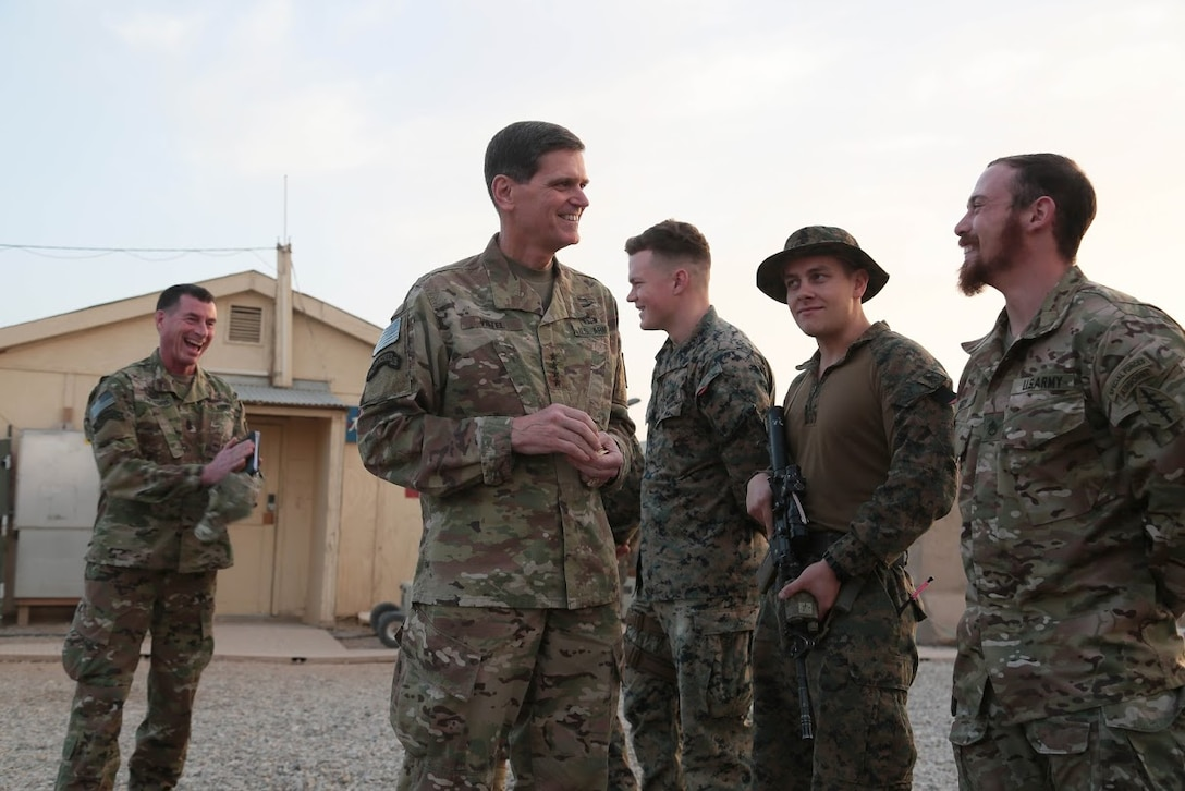 U.S. Army Gen. Joseph Votel, U.S. Central Command commander, and U.S. Army Command Sgt. Maj. William F. Thetford, U.S. Central Command senior enlisted leader give coins to U.S. Marines, Navy and Army personnel in Afghanistan, Jan. 19, 2019. The visit provides Gen. Votel with a deeper understanding of their unique capabilities and the opportunity to recognize persistent excellence in our military.