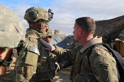 U.S. Army Command Sgt. Maj. William F. Thetford, U.S. Central Command senior enlisted leader, presents coins to soldiers during a training exercise in Iraq, Jan. 16, 2019. The 3rd Cav. Regt. is deployed in support of Operation Inherent Resolve, working by, with and through the Iraqi Security Forces and Coalition partners to defeat ISIS in areas of Iraq and Syria. ( U.S. Army photo by Sgt. Franklin Moore)