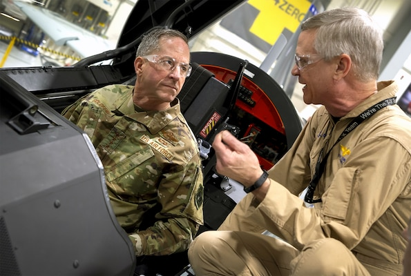 Boeing test pilot Steve Schmidt explains features of the new T-X trainer to Air Force Chief of Staff Gen. David L. Goldfein as Goldfein sits in the plane's elevated instructor's seat. Goldfein inspected the plane during a visit Jan. 15 to Boeing's St. Louis production facility.