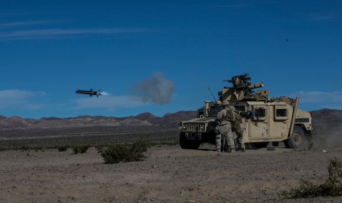 U.S. Marine Corps Cpl. Joseph Magee, left, and Cpl. Andy E. Coussens, with combined anti-armored team, 2nd Battalion, 7th Marine Regiment, 1st Marine Division, fires a tow missile, during exercise Steel Knight (SK) 2019 at Marine Corps Air Ground Combat Center, Twentynine Palms, California, Dec. 4, 2018.