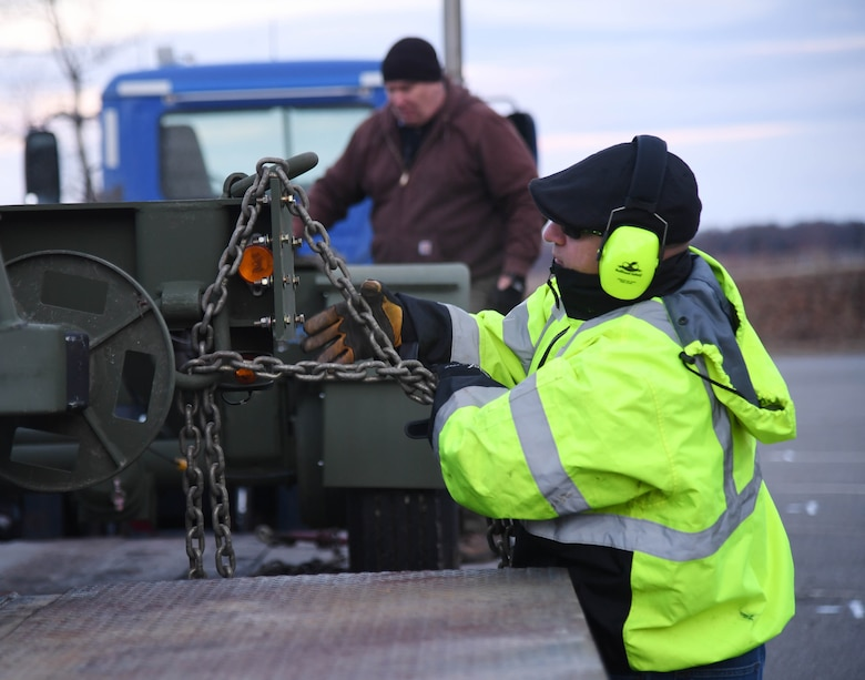 Artan Jani, 66th Logistics Readiness Squadron fuels distribution system operator, unloads a testing trailer Jan. 10 at Hanscom Air Force Base, Mass. (U.S. Air Force photo by Linda LaBonte Britt)