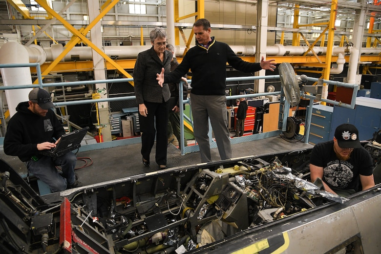 Joe Gardenhour, 573rd Aircraft Maintenance Squadron director, briefs Air Force Secretary Heather Wilson about F-16 depot maintenance during a base visit, Jan. 23, 2019, at Hill Air Force Base, Utah. The 573rd AMXS is part of the Ogden Air Logistics Complex at Hill AFB, which is responsible for depot maintenance, repair, overhaul and modification of the A-10, C-130, T-38, F-16, F-22, F-35 and the Minuteman III Intercontinental Ballistic Missile system. (U.S. Air Force photo by R. Nial Bradshaw)
