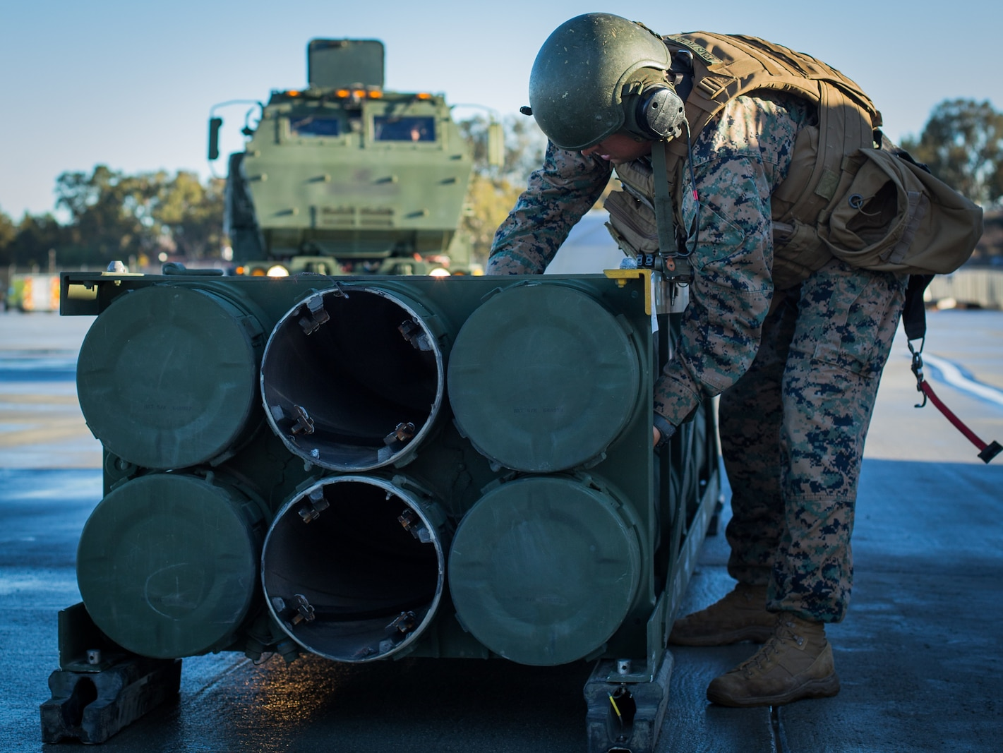 U.S. Marine Corps Staff Sgt. Shane Armstrong, an artillery cannon operator with 5th Battalion, 11th Marine Regiment, 1st Marine Division, checks a stack of M270 rockets during exercise Steel Knight (SK) 19 at Marine Corps Base Camp Pendleton, California, Dec. 7, 2018.