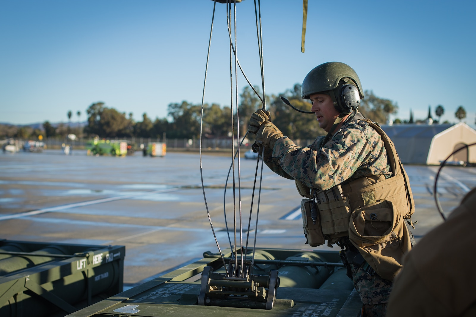 U.S. Marine Corps Staff Sgt. Shane Armstrong, an artillery cannon operator with 5th Battalion, 11th Marine Regiment, 1st Marine Division, secures a stack of M270 rockets to an M142 high-mobility artillery rocket system during exercise Steel Knight (SK) 19 at Marine Corps Base Camp Pendleton, California, Dec. 7, 2018.