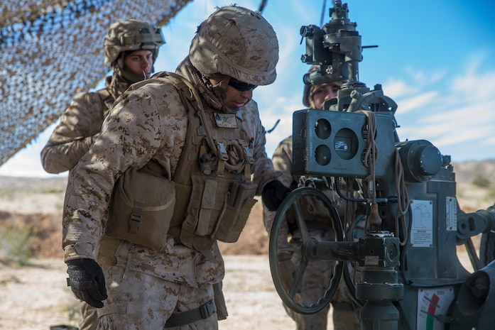 U.S. Marine Corps Sgt. Christian Gomezluna, a field artillery cannoneer with India Battery, 3rd Battalion, 11th Marine Regiment, 1st Marine Division, adjusts a M777 Howitzer, during exercise Steel Knight (SK) 2019 at Marine Corps Air Ground Combat Center, Twentynine Palms, California, Dec. 4, 2018.