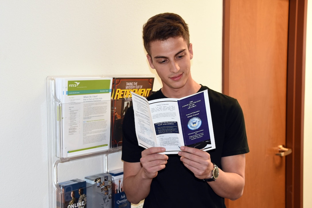 New recruit Chandler Camarena, reads a brochure about the Community College of the Air Force. Chandler's New Year's resolution is to further his education. (U.S. Air National Guard photo by Tech. Sgt. Michael Matkin)