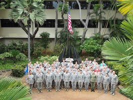 The 17th Operational Weather Squadron (OWS) poses for a group photo at the Pacific Air Forces headquarters building, Joint Base Pearl Harbor-Hickam, Hawaii, May 30, 2018. The 17th OWS was selected as the Air Force Weather Squadron of the Year for 2018. (Courtesy Photo)
