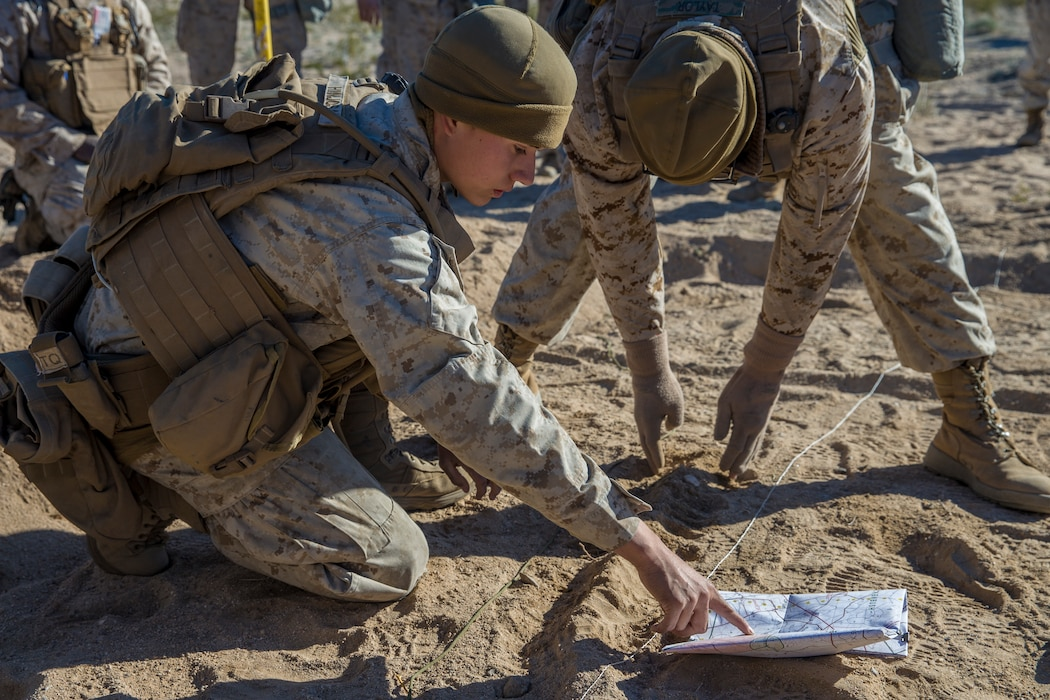 U.S. Marines with India Battery, 3rd Battalion, 11th Marine Regiment, 1st Marine Division, create a terrain modle, during exercise Steel Knight (SK) 2019 at Marine Corps Air Ground Combat Center, Twentynine Palms, California, Dec. 3, 2018.