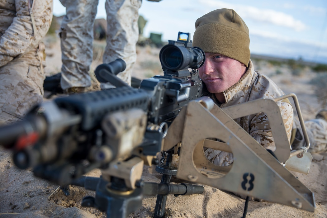 A U.S. Marine with Headquarters Battery, 11th Marine Regiment, sights in on an M240B machine gun to demonstrate proper weapons handling during exercise Steel Knight (SK) 2019 at Marine Corps Air Ground Combat Center, Twentynine Palms, California, Nov. 30, 2018.