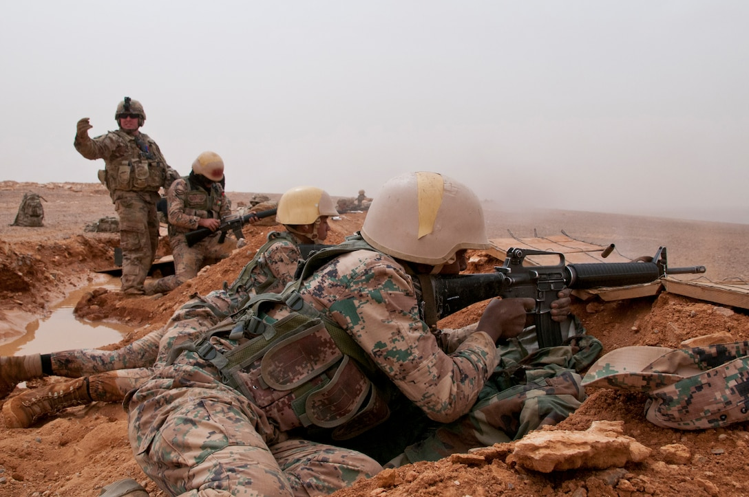 Jordanian Armed Forces soldiers engage targets with M-16s on hasty defensive line manned by U.S. and Jordanian troops near Amman, Jordan,