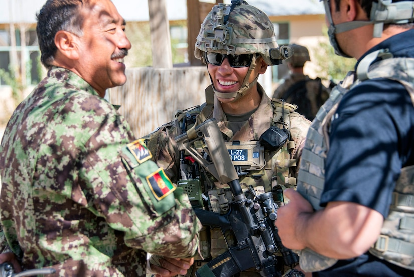Soldier with 1st Security Force Assistance Brigade's 3rd Squadron meets with Afghan Command's senior enlisted leader (left) during routine fly-to-advise