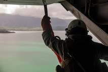 A U.S. Marine Corps crew chief with Marine Medium Tiltrotor Squadron 363 prepares a hoist hook, Marine Corps Air Station Kaneohe Bay, Marine Corps Base Hawaii, Jan. 24, 2019. The purpose of this training is to enhance evacuation capabilities of personnel utilizing the MV-22B Osprey in the event of a military or civilian mishap at sea. The ability to hoist stranded individuals from the water with tiltrotor aircraft provides additional life-saving response options for Hawaii-based Marine's and the III Marine Expeditionary Force. (U.S. Marine Corps photo by Cpl Brendan Custer)